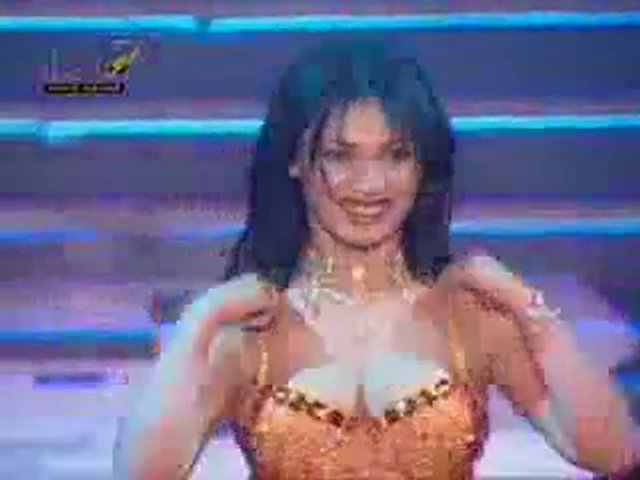 An Arabian lady dancing in Arabian tune. Arab music. Lovely Arabian dance