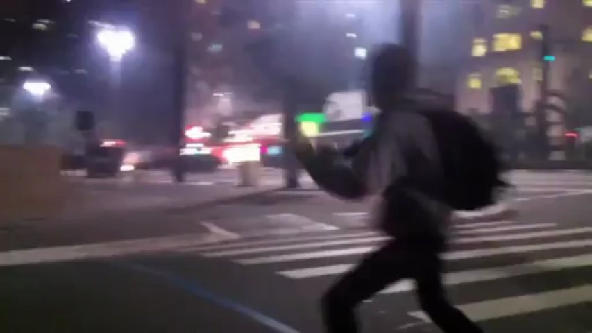 Brazilian youth dances in front of riot police