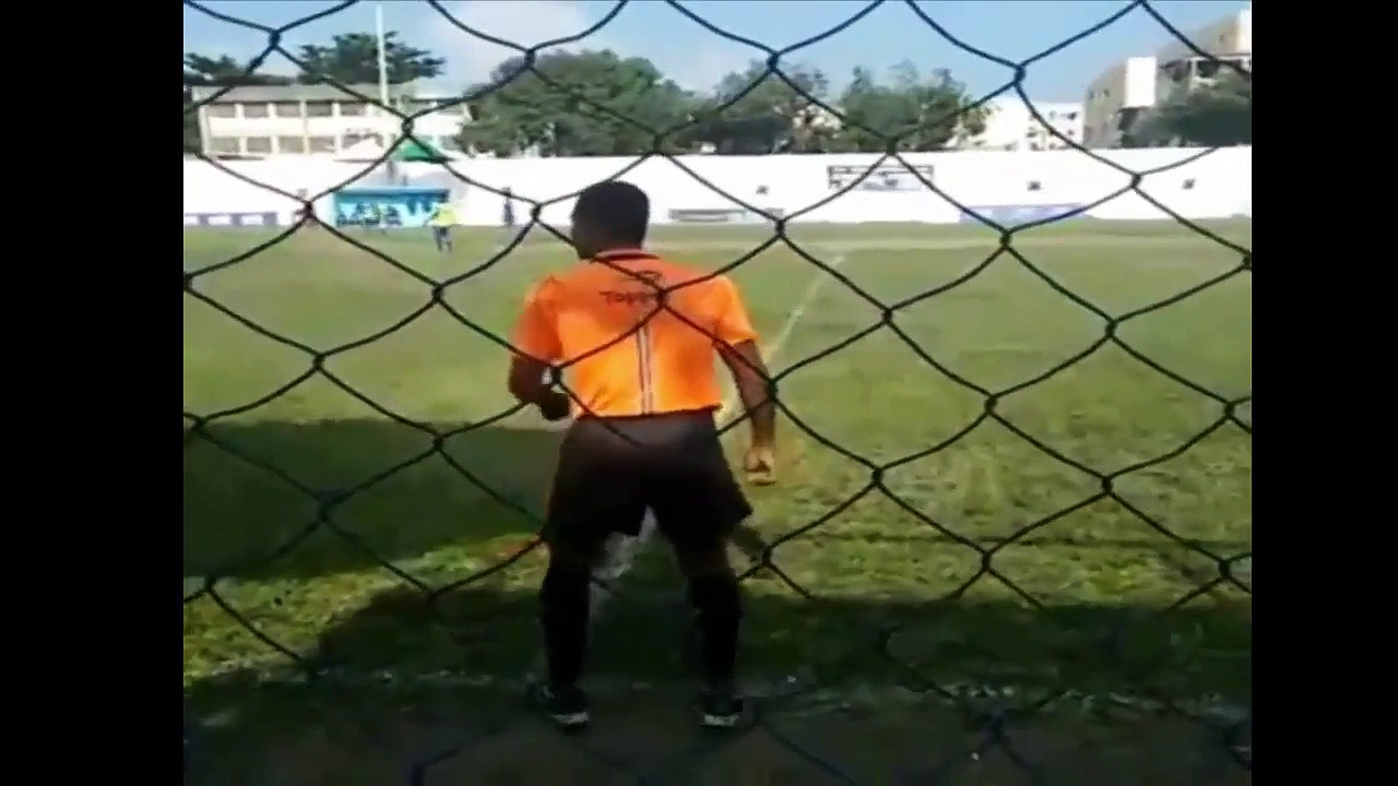 A Brazilian linesman entertains the crowd by dancing on the sidelines during a game