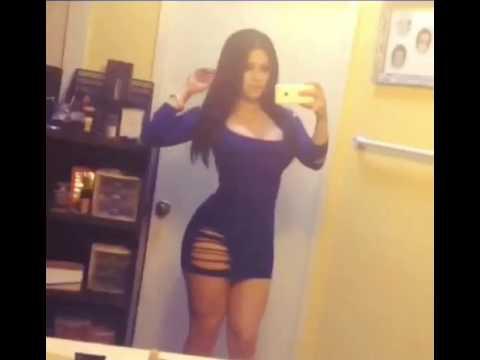 Sexy Latina posing in tight blue dress