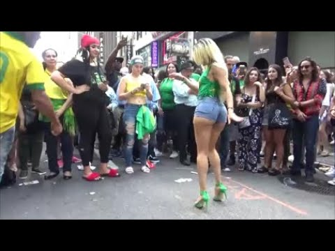 BRAZILIAN GIRLS DANCERS DANCE SAMBA AT BRAZILIAN CARNIVAL STREET PARTY